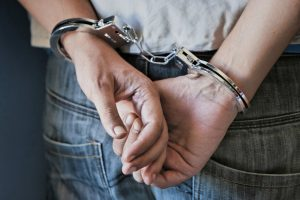 Man handcuffed from behind