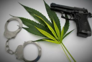 Marijuana, gun, and handcuffs