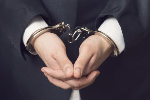 Man in suit and handcuffs