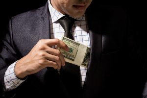 Man putting money in suit
