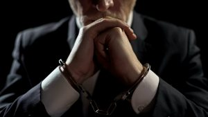 Man in suit with handcuffs