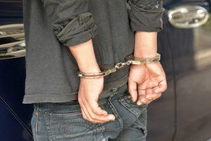 Youth under arrest