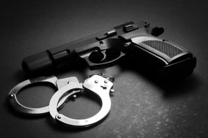 Gun and cuffs