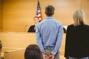 handcuffed man in court
