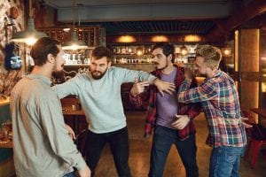 drunk people fighting in a pub
