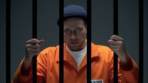 Caucasian man in jail cell